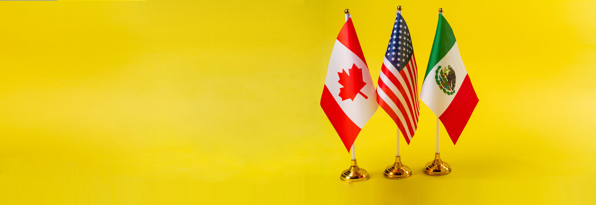 canada usa and mexico flag on yellow background